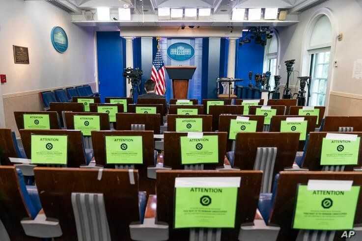The White House's Brady press briefing room is almost empty, Friday, Oct. 2, 2020, in Washington. President Donald Trump said…