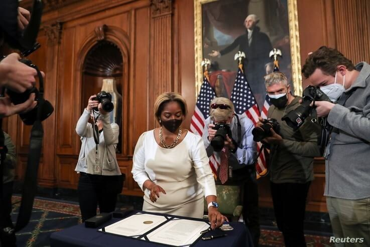 Latrice Powell lays down the article of impeachment against U.S. President Donald Trump, which U.S. House Speaker Nancy Pelosi …