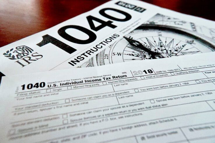 FILE- This Feb. 13, 2019, photo shows multiple forms printed from the Internal Revenue Service web page that are used for 2018 U.S. federal tax returns, in Zelienople, Pennsylvania.