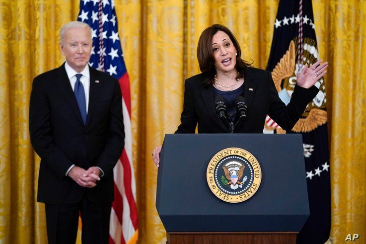 President Joe Biden listens as Vice President Kamala Harris speaks before signing the COVID-19 Hate Crimes Act, in the East…