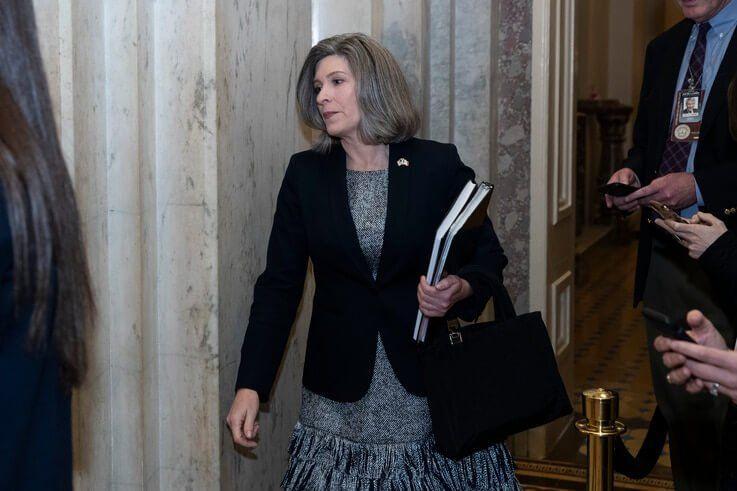 Sen. Joni Ernst, R-Iowa, walks on Capitol Hill, Monday, Feb. 3, 2020 in Washington. (AP Photo/Alex Brandon)