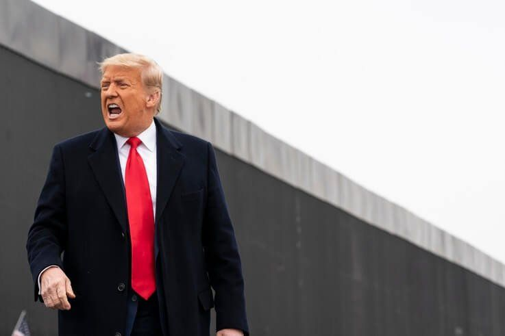 President Donald Trump reacts after speaking near a section of the U.S.-Mexico border wall, Tuesday, Jan. 12, 2021, in Alamo,…