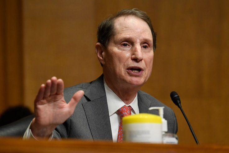 Sen. Ron Wyden, D-Ore., questions Internal Revenue Service Commissioner Charles Rettig at a Senate Finance Committee hearing on…
