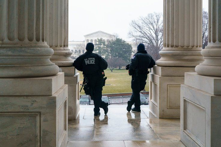 U.S. Capitol Police officers stand watch outside the Senate as lawmakers vote on procedures to proceed with the impeachment of…
