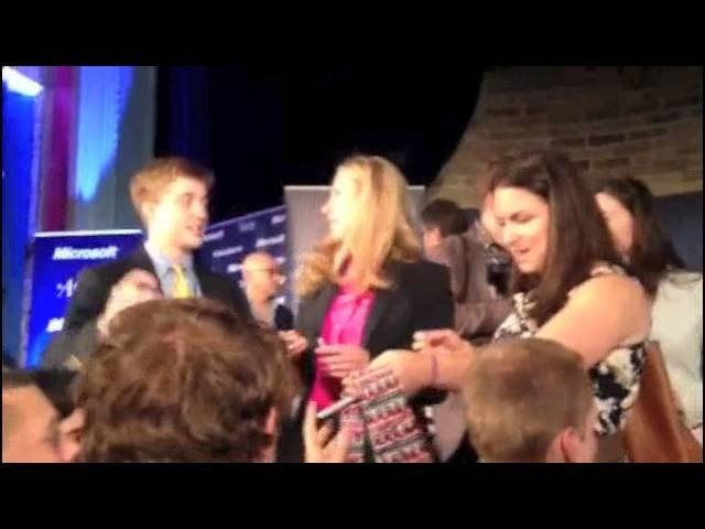 Chelsea Clinton autographs a tie