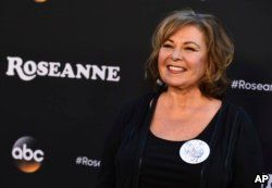 """Roseanne Barr arrives at the Los Angeles premiere of """"Roseanne,"""" March 23, 2018 in Burbank, Calif."""