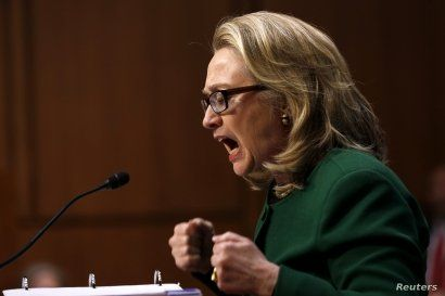 U.S. Secretary of State Hillary Clinton pounds her fists as she responds to intense questioning on the September attacks on U.S. diplomatic sites in Benghazi, Libya, during a Senate Foreign Relations Committee hearing on Capitol Hill in Washington, D