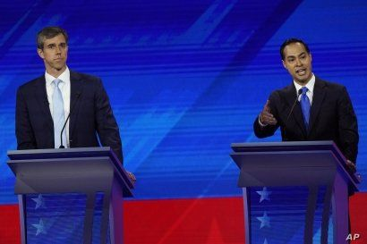 Former Texas Rep. Beto O'Rourke, left, listens as former Housing and Urban Development Secretary Julian Castro, right, responds to a question Thursday, Sept. 12, 2019, during a Democratic presidential primary debate hosted by ABC at Texas Southern…