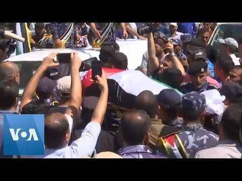 Thousands Bury Police Officers Killed in Rare Gaza Attacks