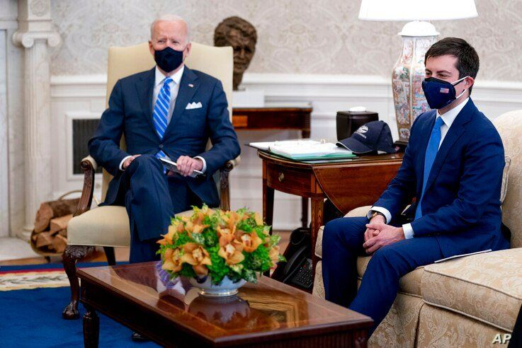 FILE - In this March 4, 2021, file photo, President Joe Biden and Transportation Secretary Pete Buttigieg, right, meet with…