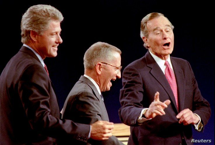 Independent candidate Ross Perot (C) seen here with Democratic Presidential nominee Governor Bill Clinton (L) and President George Bush at the 1992 presidential debate in East Lansing, Michigan, went on to win 19% of the popular vote in the November election.