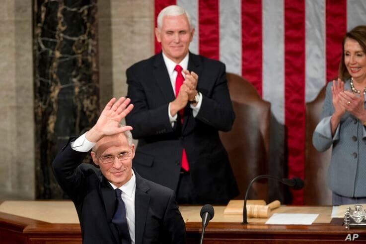 NATO Secretary General Jens Stoltenberg, left, accompanied by Vice President Mike Pence, center, and House Speaker Nancy Pelosi…