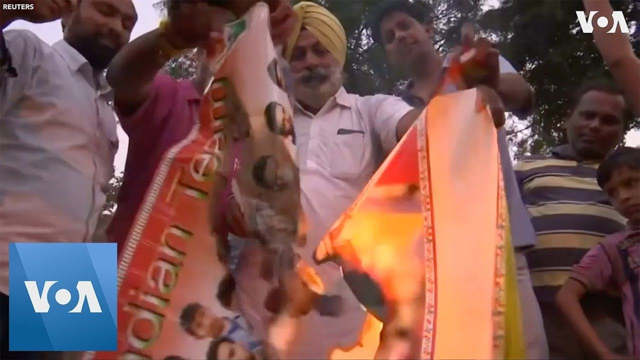 Indian Cricket Fans Burn Posters in Reaction to World Cup Loss