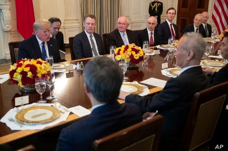 President Donald Trump and Chinese Vice Premier Liu He have lunch after signing the 'Phase 1' U.S.-China trade agreement, in the State Dining Room of the White House, Jan. 15, 2020, in Washington.
