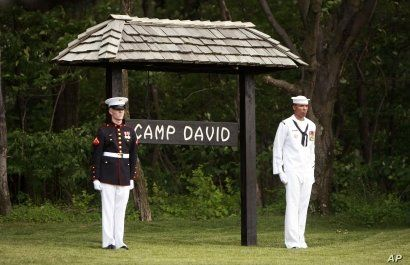 Members of an honor guard stand at attention at Camp David, Md. (file photo).