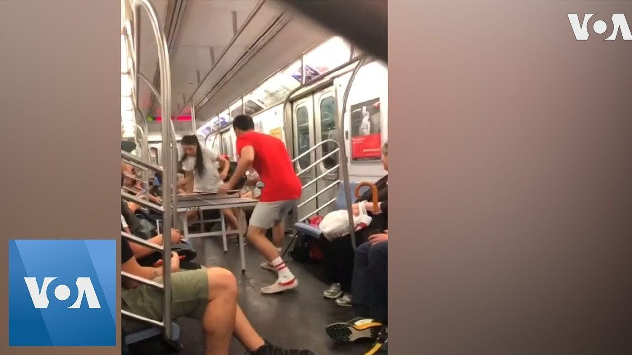 Ping-Pong Players Play Game on New York City Train