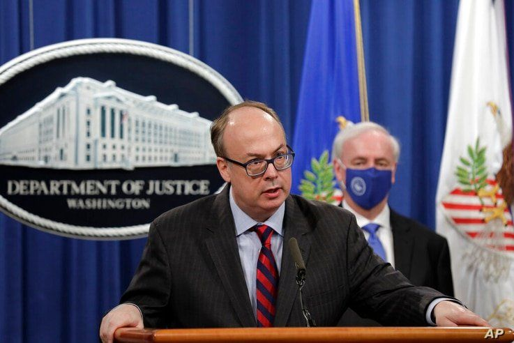 Acting Assistant U.S. Attorney General Jeffrey Clark speaks as he stands next to Deputy Attorney General Jeffrey A. Rosen…