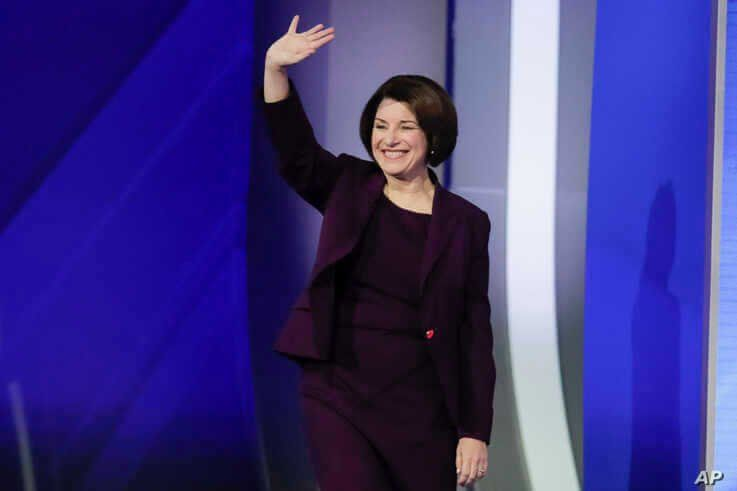 Sen. Amy Klobuchar, D-Minn., waves on stage Friday, Feb. 7, 2020, before the start of a Democratic presidential primary debate…