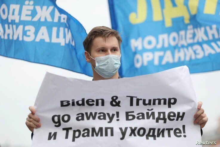 An activist of the Liberal Democratic Party of Russia (LDPR) holds a placard during a demonstration ahead of the U.S…