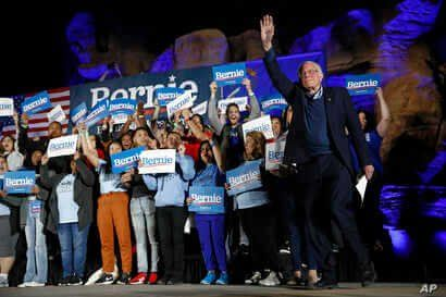 Democratic presidential candidate Sen. Bernie Sanders, I-Vt., walks onstage to speak at a campaign event at Springs Preserve in…