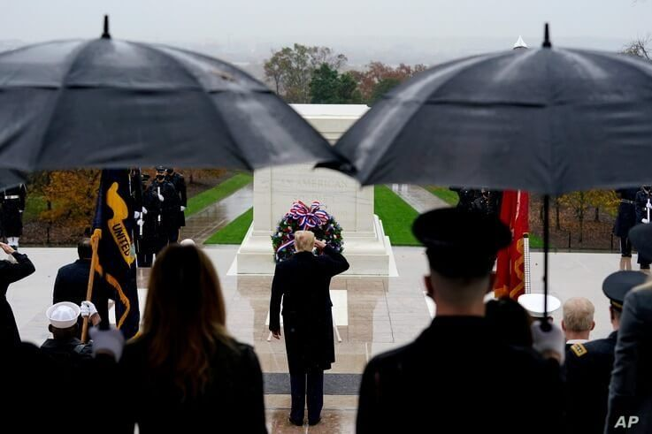 President Donald Trump participates in a wreath laying ceremony on Veterans Day at Arlington National Cemetery in Arlington, Virginia, Nov. 11, 2020.