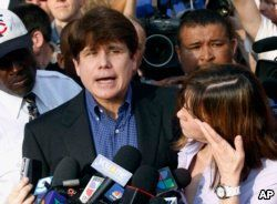FILE - In this March 14, 2012 file photo, former Illinois Gov. Rod Blagojevich, accompanied by his wife Patti, speaks to the media outside his home in Chicago.