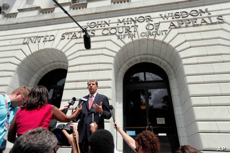 Robert Henneke, general counsel and director for the Center for the American Future, speaks to reporters outside the 5th…