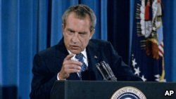 FILE - President Richard Nixon gestures sternly during a press conference in Washington in 1973.