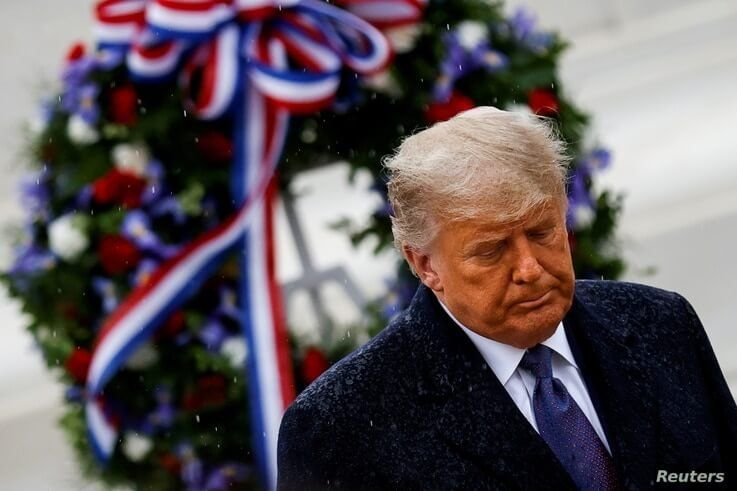 U.S. President Donald Trump departs after placing a wreath at the Tomb of the Unknown Solider on Veterans Day.