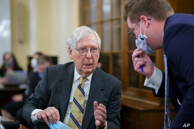 Senate Minority Leader Mitch McConnell, R-Ky., turns to an aide as the Senate Rules Committee holds a hearing on the