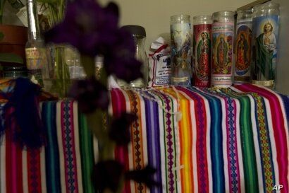 This Wednesday, July 17, 2019, photo shows the bedroom of Maria Chavalan Sut, an indigenous woman from Guatemala, as devotional…