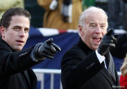 FILE - U.S. Vice President Joe Biden, right, and his son Hunter point to some faces in the crowd as they walk down Pennsylvania Avenue following the inauguration ceremony of President Barack Obama in Washington, Jan. 20, 2009.