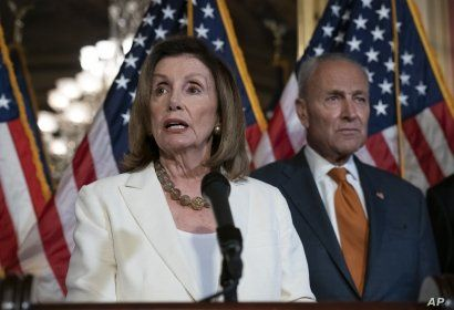 FILE - Speaker of the House Nancy Pelosi, D-Calif., joined at right by Senate Minority Leader Chuck Schumer, D-N.Y., calls for a Senate vote on the House-passed Bipartisan Background Checks Act at the Capitol in Washington, Sept. 9, 2019.