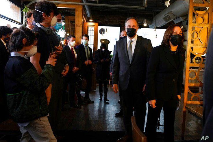 Vice President Kamala Harris and her husband Doug Emhoff arrive at Maria Empanada, Tuesday March 16, 2021, in Denver. (AP Photo…