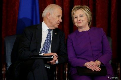 U.S. Vice President Joe Biden (L) and former Secretary of State Hillary Clinton (R) attend a ceremony to unveil a portrait honoring retiring Senate Minority Leader Harry Reid (D-NV) on Capitol Hill in Washington, U.S. December 8, 2016.  REUTERS/Jonathan Ernst