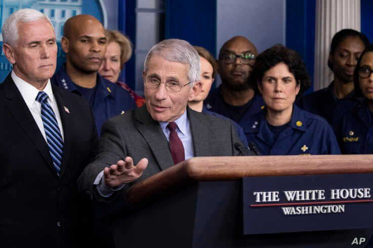 Dr. Anthony Fauci, director of the National Institute of Allergy and Infectious Diseases, with Vice President Mike Pence behind him, speaks during a briefing about the coronavirus in the James Brady Press Briefing Room of the White House, March 15, 2020.