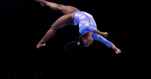 US Olympic gymnastics star Simone Biles withdraws from women's team event with apparent foot injury