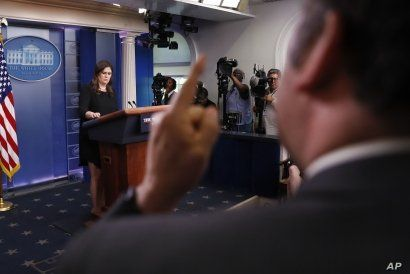 Brian Karem, right, White House correspondent for Playboy magazine, gestures as he reacts to responses by then-White House press secretary Sarah Huckabee Sanders, left, during a daily briefing at the White House, in Washington, June 14, 2018.