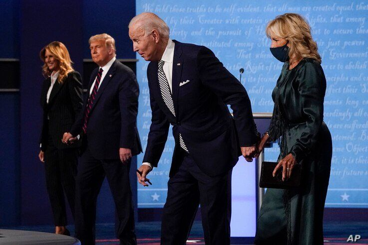 From l-r, first lady Melania Trump, President Donald Trump, Democratic presidential candidate former Vice President Joe Biden…