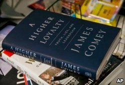 """FILE - A copy of former FBI Director James Comey's new book, """"A Higher Loyalty: Truth, Lies and Leadership,"""" is on display, Apr. 13, 2018, in New York."""