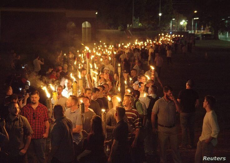 White nationalists carry torches on the grounds of the University of Virginia, on the eve of a planned