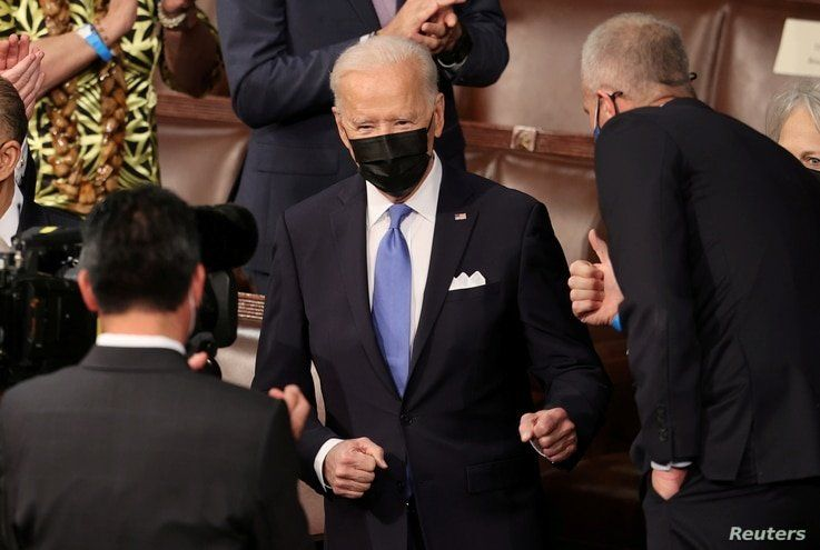 U.S. President Joe Biden arrives to deliver his first address to a joint session of the U.S. Congress at the U.S. Capitol in Washington