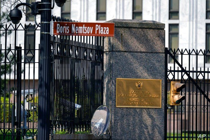 A street sign marking Boris Nemstov Plaza is seen at the entrance of the Embassy of the Russian Federation in Washington,…