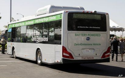 FILE - An electric bus produced by China's BYD Co. is parked at the announcement of the opening of an electric bus manufacturing plant in Lancaster, Calif., May 1, 2013.