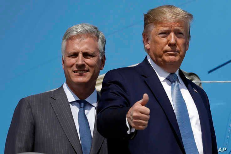 President Donald Trump and Robert O'Brien, just named as the new national security adviser, board Air Force One at Los Angeles…