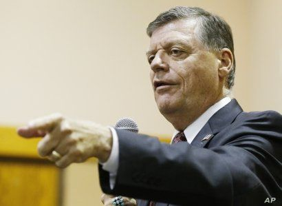 FILE - U.S. Rep. Tom Cole, R-Okla., shown at a town hall meeting in Moore, Okla., in August 2015, said Donald Trump's second-place finish to Ted Cruz in the Iowa caucuses had erased the billionaire candidate's aura of inevitability.