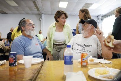 Democratic presidential candidate Sen. Amy Klobuchar talks with attendees during the Hawkeye Area Labor Council Labor Day Picnic in Cedar Rapids, Iowa, Sept. 2, 2019.
