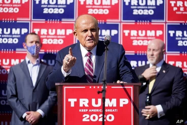 Former New York mayor Rudy Giuliani, a lawyer for President Donald Trump, speaks during a news conference on legal challenges…