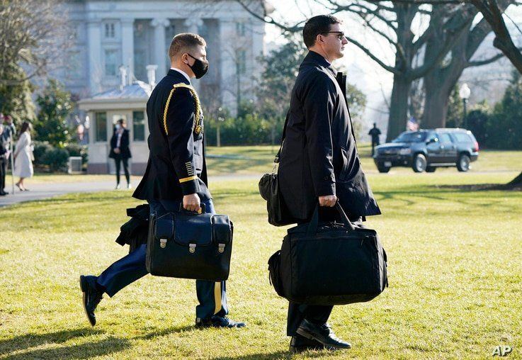A U.S. military aide, left, carries the