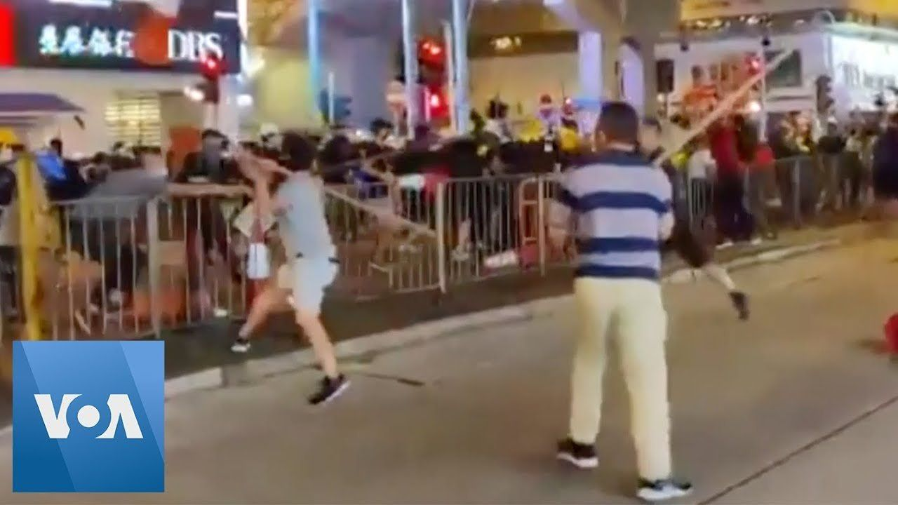 Pole-Wielding Men Attack Hong Kong Protesters